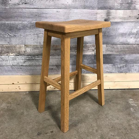 Saddle seat oak counter stool