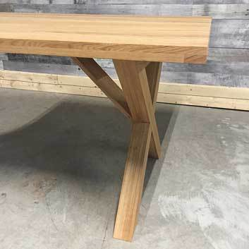 Thick 2 inch table top featuring solid oak legs