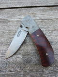 Rideau Knives Liner Lock Folder in Stainless Damascus with Snakewood Scales