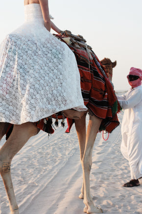 The Johanna Wedding Dress cropped shot of hem with bride on a camel