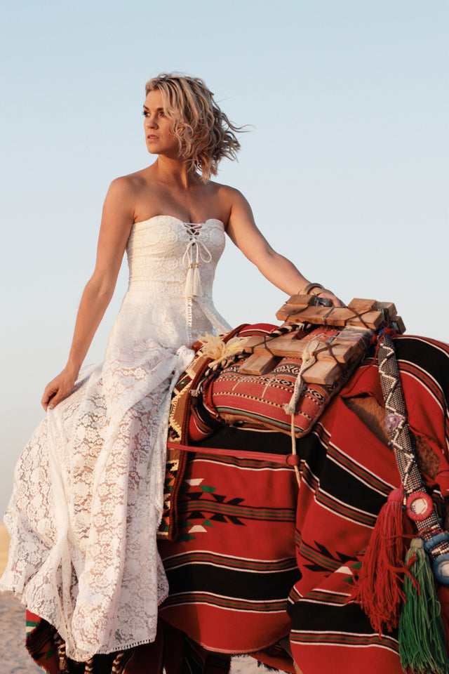 The Johanna Wedding Dress three quarter front with bride riding a camel
