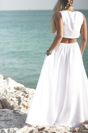 The West Wedding Dress cropped behind of bride on rocks