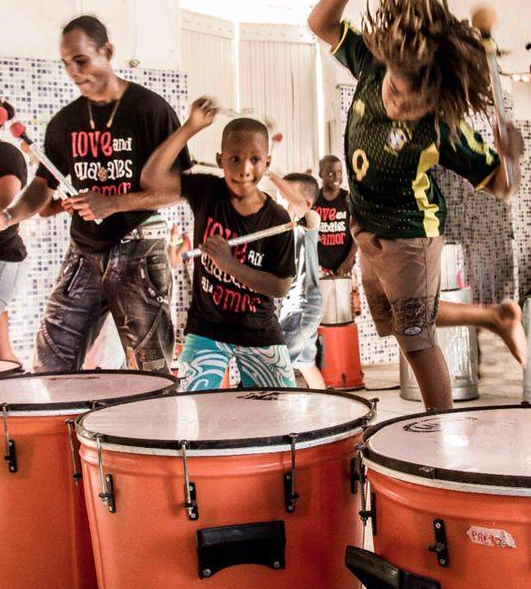 Drumming Up Change: Social Impact Of Buckets And Brooms