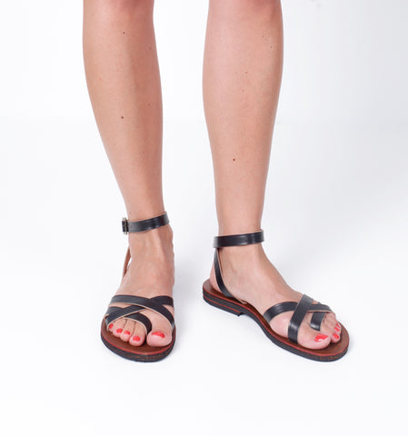 sol sandals caboclo black leather sustainable on feet