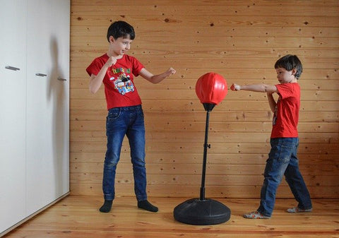 children practicing boxing together