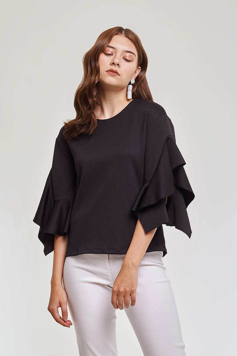 modest loose fitting black blouse with frills on sleeves