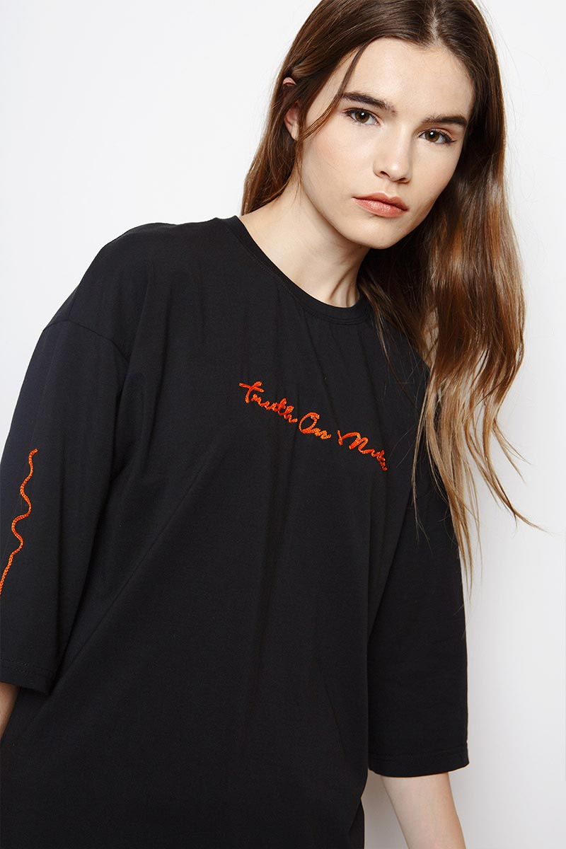 Muzca Slogan Tees In Supima Modest Loose Fitting Black T-Shirt with Oversized Fit and Orange Text