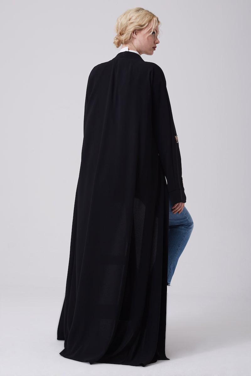 FERADJE modest black abaya with gold bee patches made from crepe back view