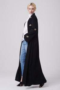 FERADJE modest black abaya with gold bee patches made from crepe side view