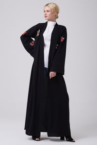 FERADJE black modest abaya with embroidery patches of numbers like a basketball jacket made from crepe full length view