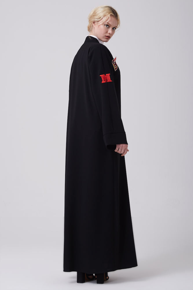 FERADJE black modest abaya with embroidery patches of numbers like a basketball jacket made from crepe side view
