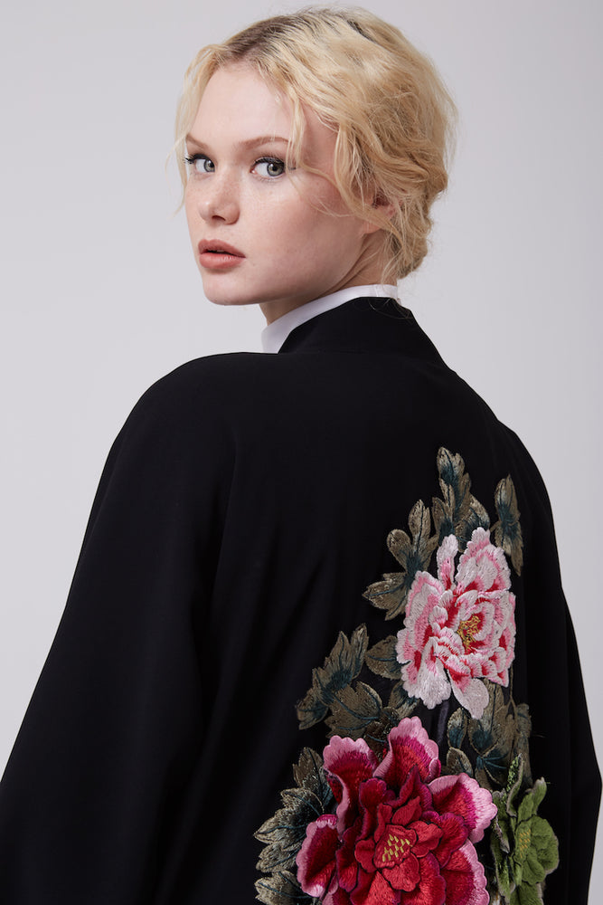 FERADJE modest black abaya or kimono with a flowery embroidery made from the finest crepe close up view