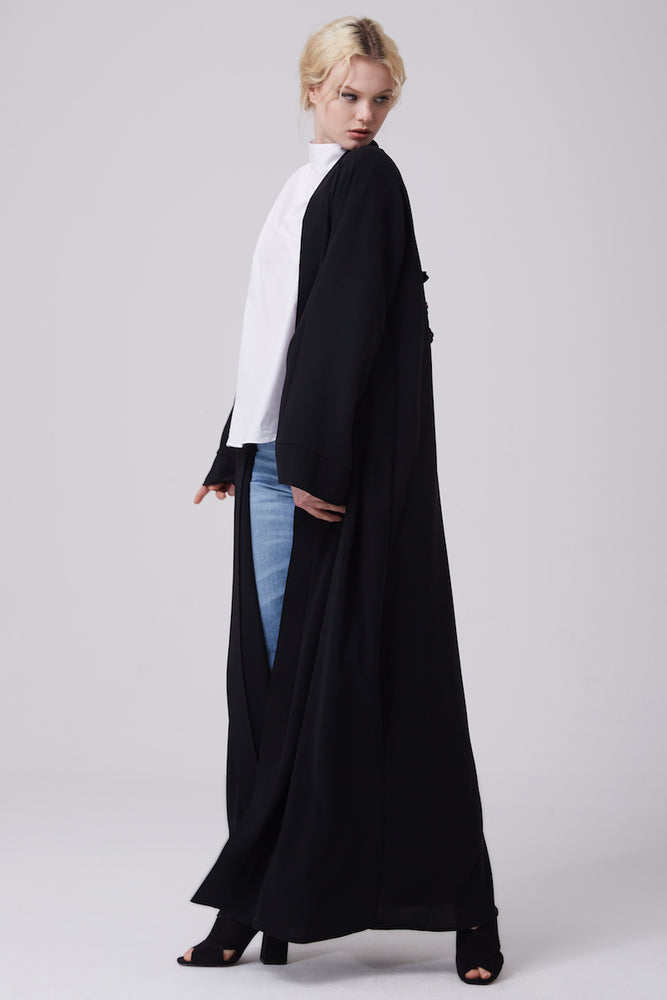 FERADJE modest black abaya or kimono with a flowery embroidery made from the finest crepe side view