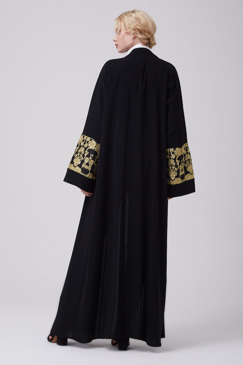 FERADJE modest black abaya with gold lace details on sleeves made from crepe back view