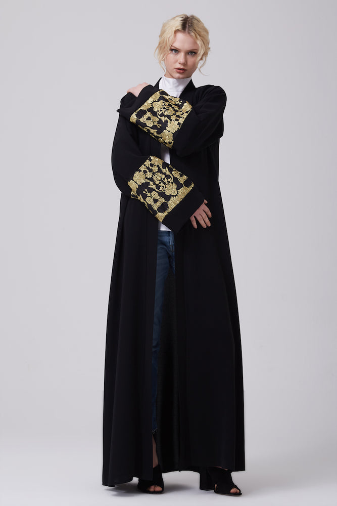 FERADJE modest black abaya with gold lace details on sleeves made from crepe front view