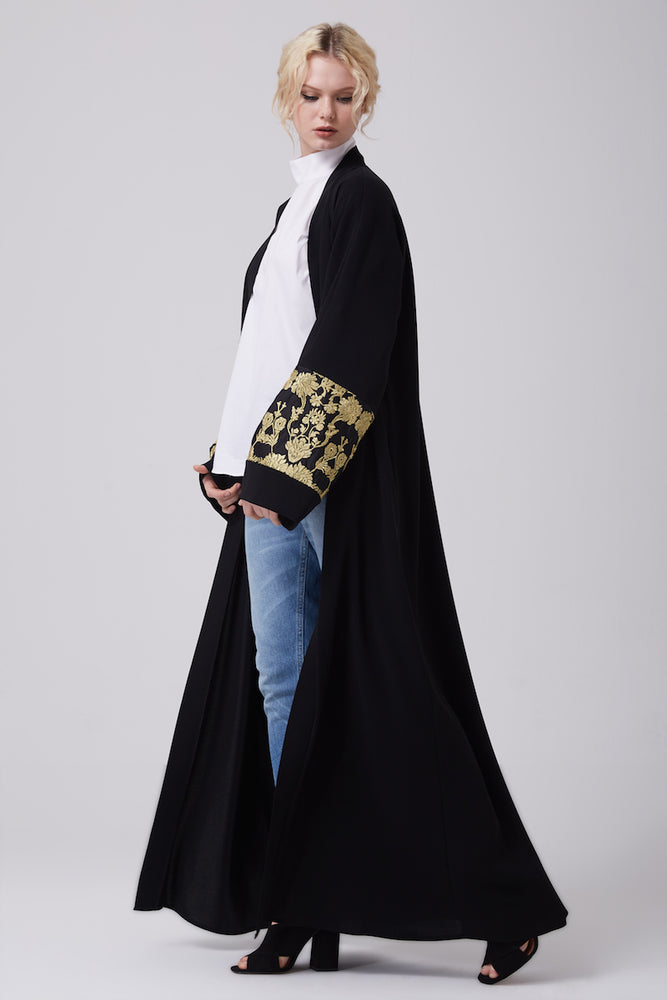 FERADJE modest black abaya with gold lace details on sleeves made from crepe full length view