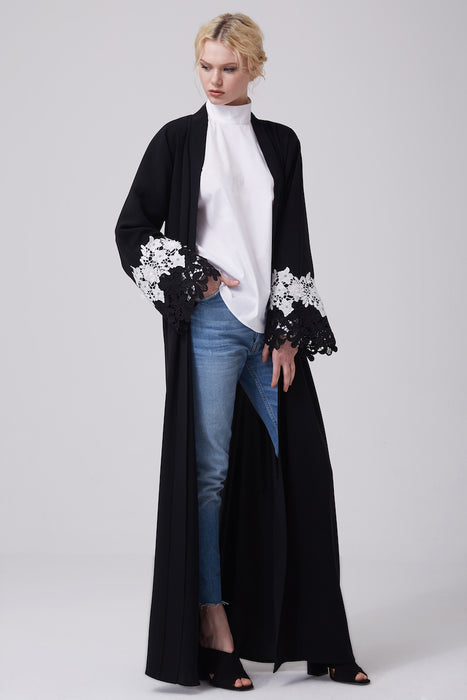 FERADJE modest black abaya with black and white lace on sleeves made from crepe front view