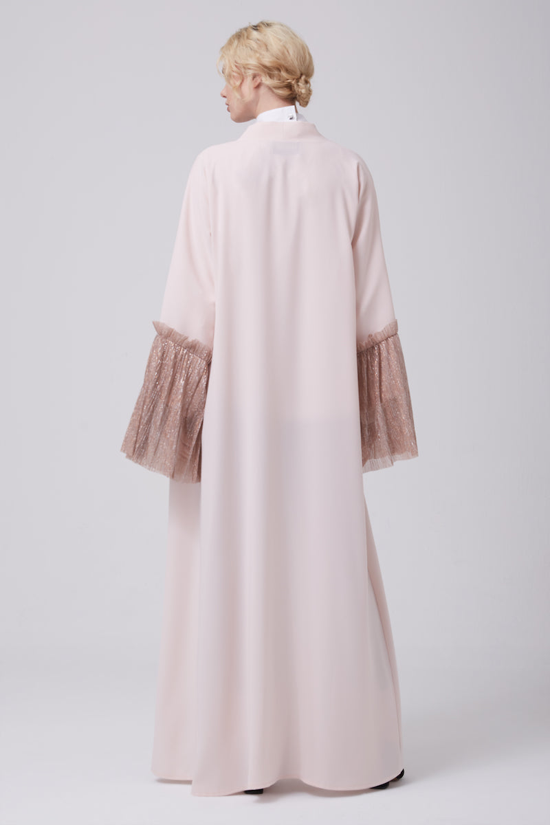 FERADJE open-front abaya with bell sleeves on Silver and Pink its made from crepe and crimped silvery fabric at the cuffs back view