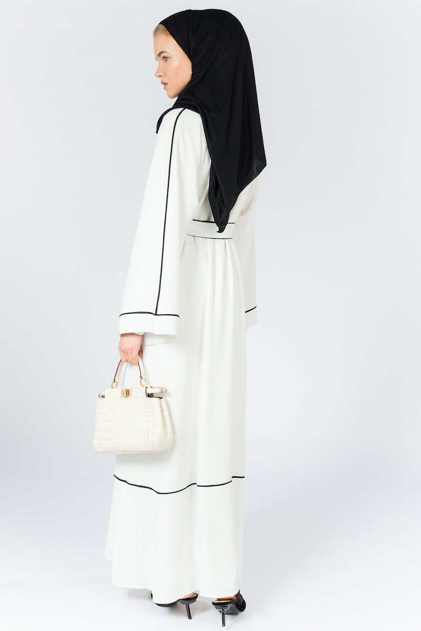 FERADJE Modest Women Ayesha Abaya in white with fine black lines and comes with a matching belt. The classic but trendy design make this abaya ideal for any occasion and it's made from 100% crepe back view