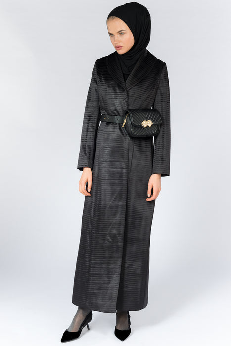 FERADJE Modest Women Royal Abaya in black with collar and elegant pleated abraham fabric. It is unbuttoned and has fitted straight arms. It is design as a coat so it's perfect for any occasion and season full length view