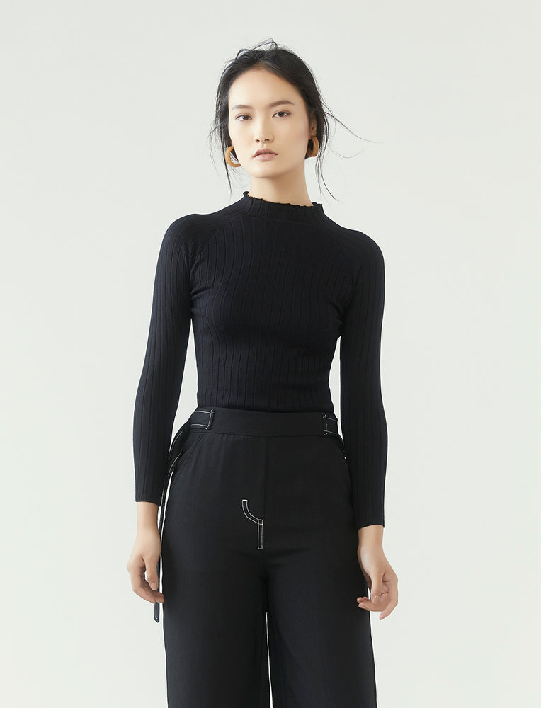 r y e  Modest Women Ribbed Knit Long Sleeve Top in Black with ribbed details and high neck collar made from 95% Viscose and 5% Spandex close up view