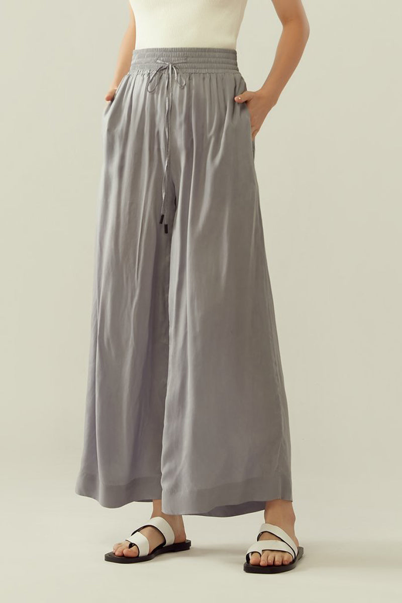 r y e Cupro Drawstring Flared Pants in Light Slate Modest Loose Fitting Ankle-Length Grey Trousers With Pockets, Elastic Waistband