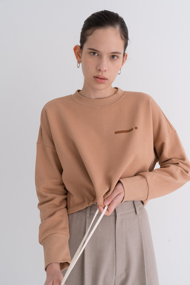 NOTA Essential Bottom String Mtm Beige Modest Loose-Fitted Women's Top With Long Sleeves, Drawstring Hemline in 100% Cotton