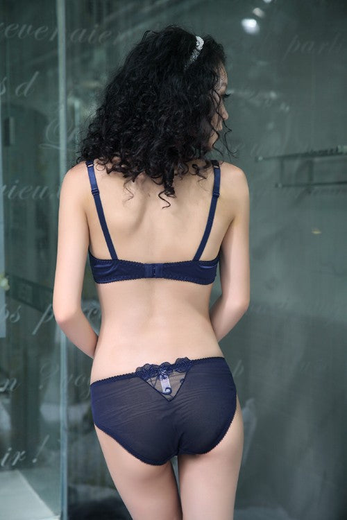 model wearing black panty and bra in back side
