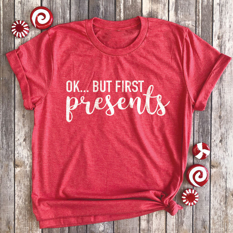 Ok, But First Presents Premium Unisex T-Shirt