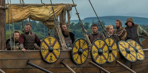 Viking warriors on the Viking ships. They arranged the Viking shields on the sides of their ship