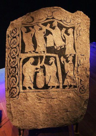 Viking stone depicting people feasting and drinking in the drinking horn