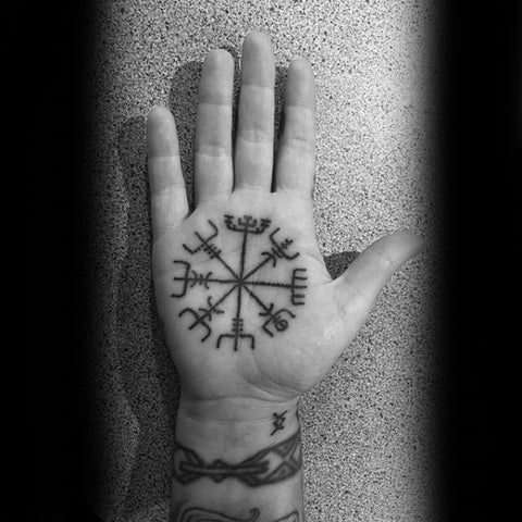Image of Viking compass Vegvisir tattoo in hand