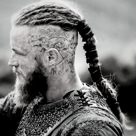 Viking ragnar tattoo in the head as Odin's tattoo