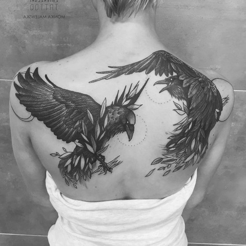 Viking raven tattoo in the back as the odin's tattoo