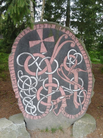 "Viking runestone with the Viking Urnes style. The runes on the surface reads:""Bjorn Odulv, Gunnar, Holmdis erected this stone in memory of Ulv, Ginnlog's husband. And Asmund carved it"""