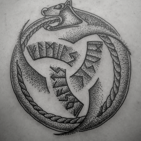 Viking tattoo of Viking serpent and the Odin's triple horn. Odin's tattoo