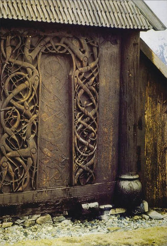 Viking art Viking urnes style in the door of the church in Urnes, Norway