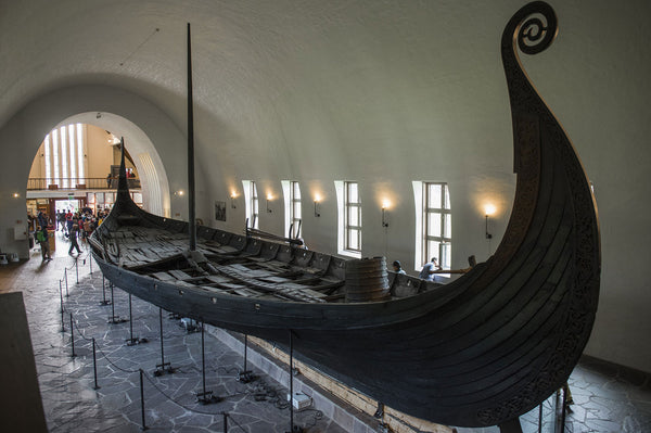 Viking ship Viking Oseberg ship in the museum. The Vikings buried the wealthy and noble figures with their ship which was believed to bring the Vikings to the better afterlife