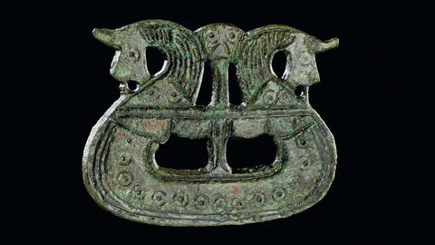 Viking ship-shaped brooch dating back to 9th century in Tjørnehøj II, Fyn, Denmark