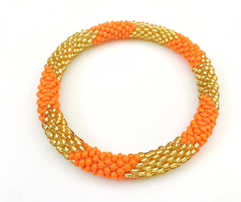 Tunique Peach and Gold Rollover Glass Bead Bracelets