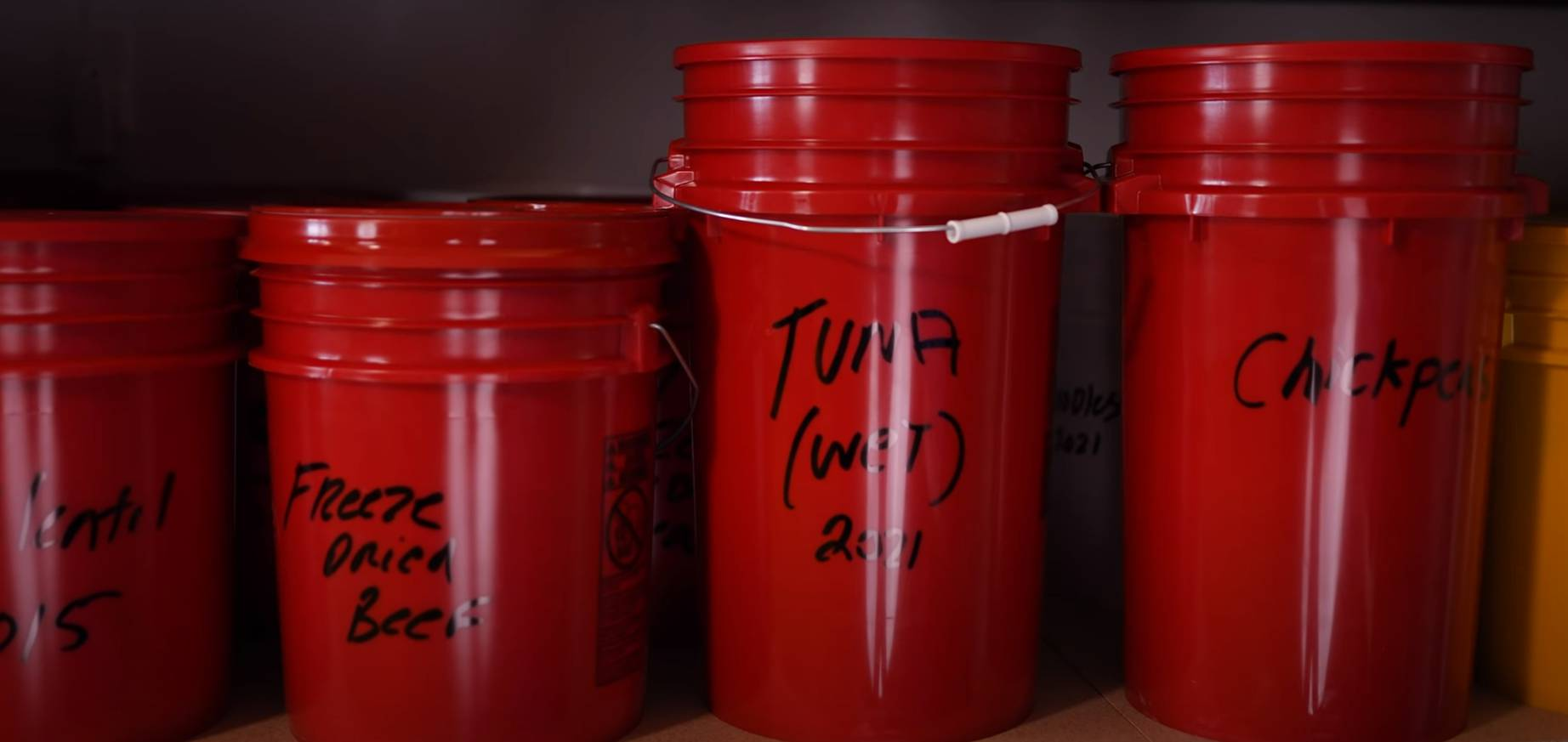 food storage buckets with labels