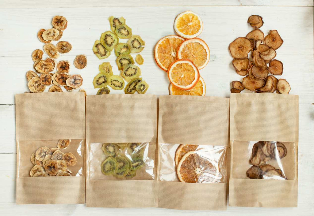 Brown and clear bags of dehydrated fruits laid out side by side
