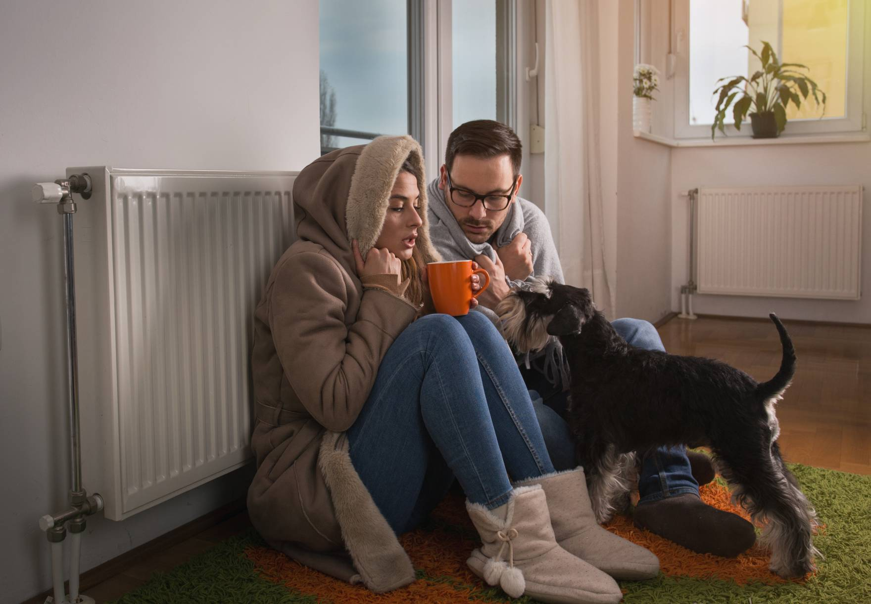 Family keeping warm in cold home
