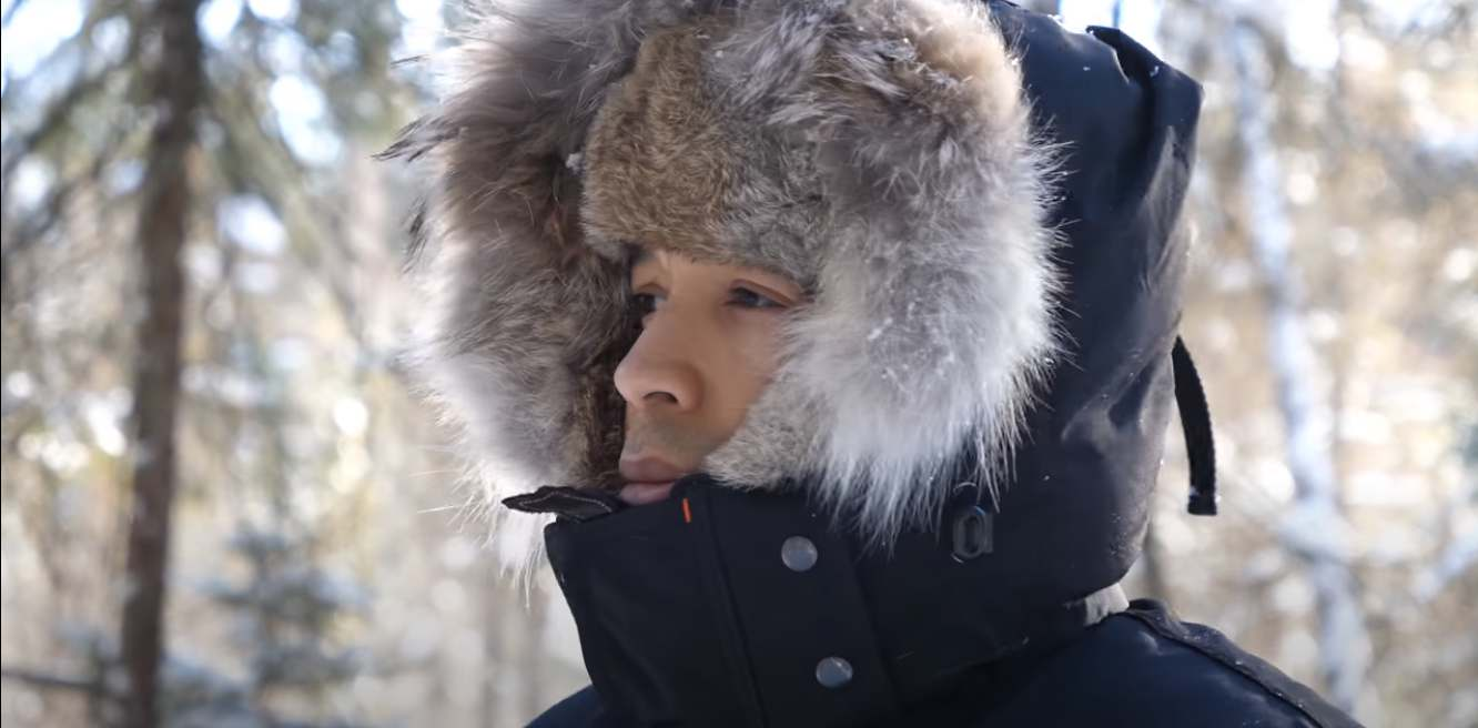 Prepper wearing fur hat and synthetic coat over Canada goose down snow pants