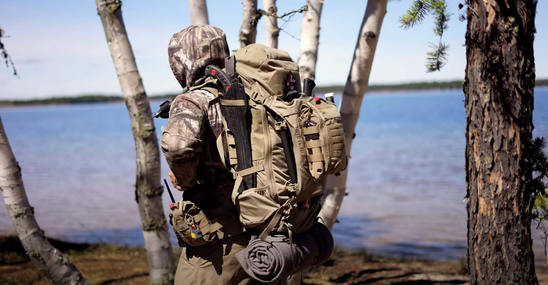 canadian prepper wearing the markhor 45 backpack near a lake