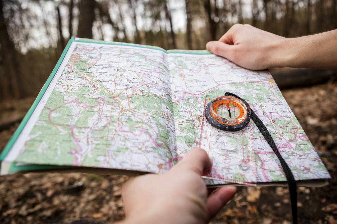 Compass and map to navigate a forest