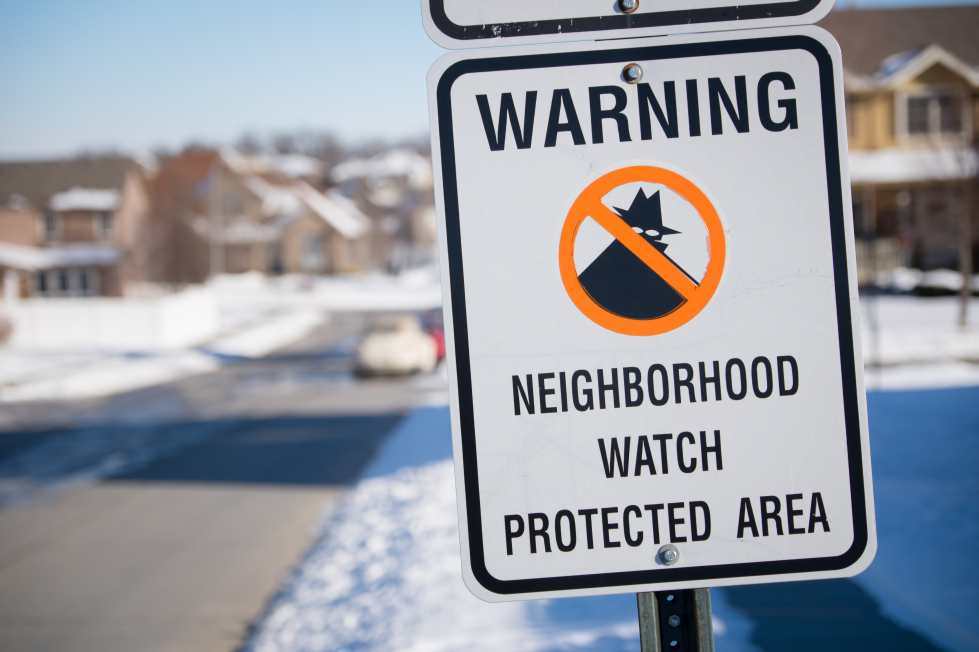 Neighborhood watch sign on a  community street in the winter time