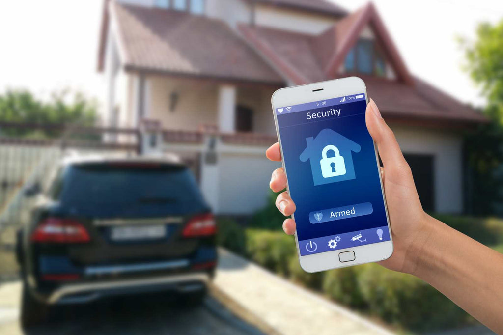 A person receiving a home surveillance warning from a security app on their mobile phone.
