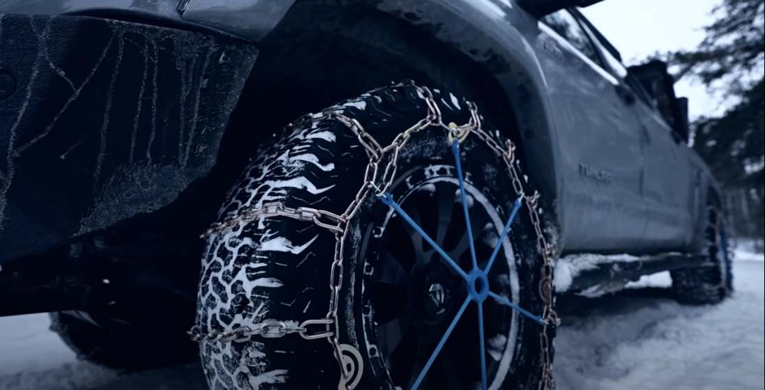 Tire chains installed on a toyota truck in the winter time
