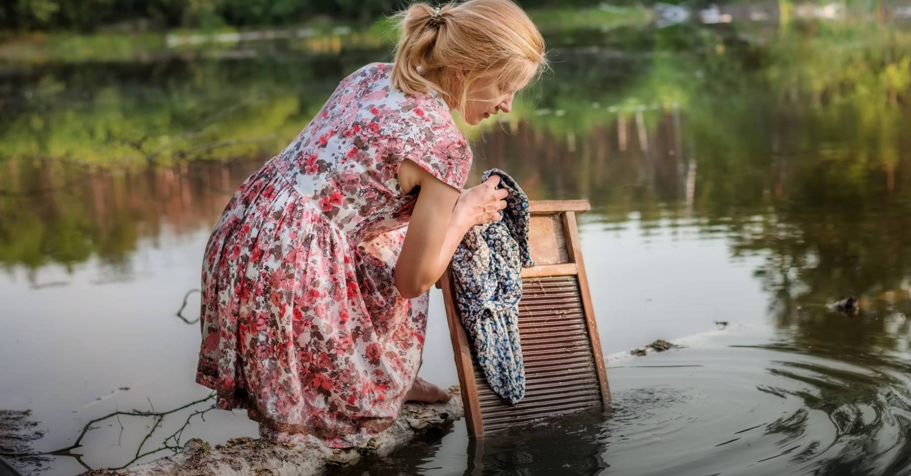 washboard to clean clothes in a lake